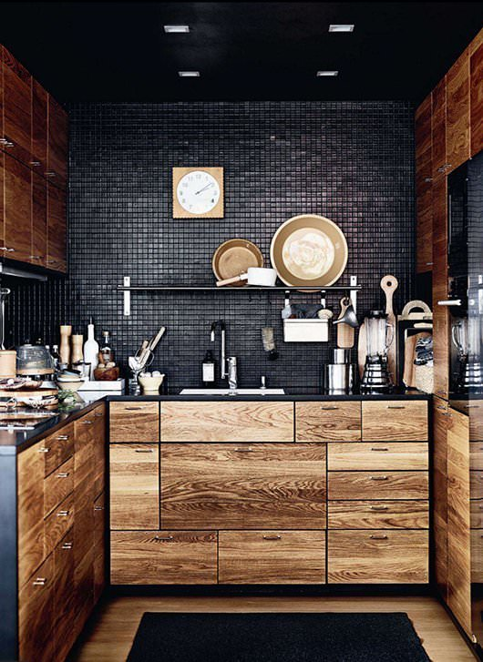 I'm hooked on this weathered wood cabinet and black Zellige tiled kitchen.