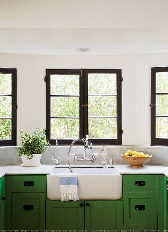 This Kelly green kitchen is so sweet and darling.
