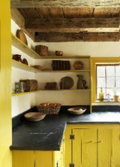Yellow kitchen cabinets make this kitchen stand out.