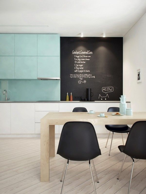 so clean. everything lines up. the table + chalkboard wall + the black chairs