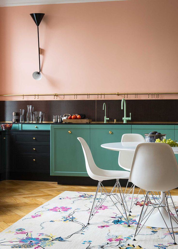 details. the border around the cabinets, the colored faucets. and the pink wall is perfect.