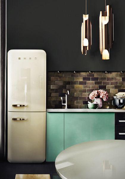moody. i love smeg fridges. and again a great faucet design.