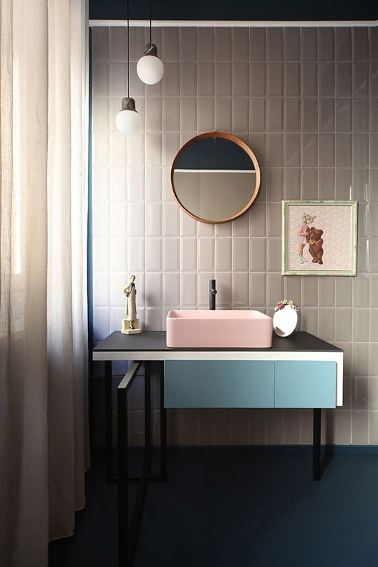 A pink sink + that wall art + the decorative pieces on the counter = they had fun here.