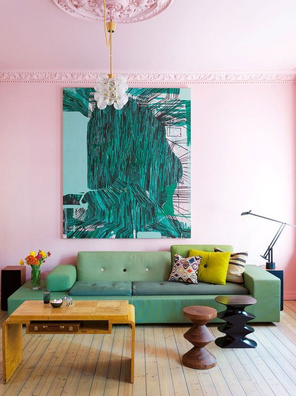 Exaggerated pink (walls, trim, ceiling, even the medallion) + asymmetry + many variations of green = everything is pretty much playful here.