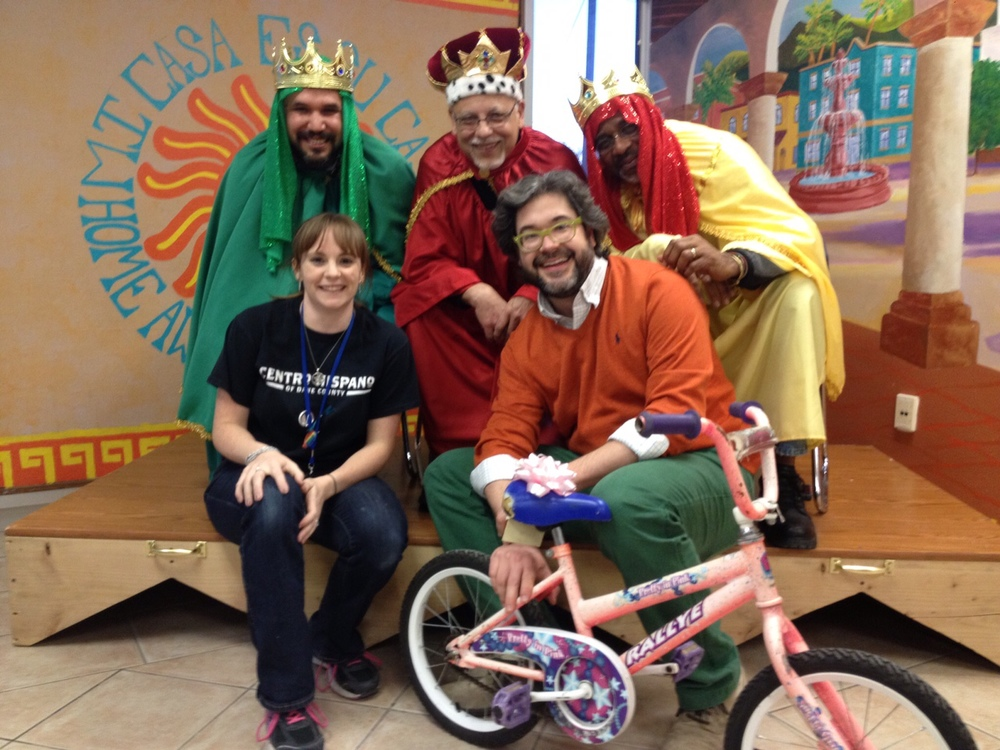 Wheels for Winners partnered with Centro Hispano to give out toddler-sized and small youth bicycles during the 2015 Tres Reyes celebration, held in January. Pictured with the Three Kings are Lauren Deakman, Director of Youth Programs for Centro Hispano and Wheels for Winners Board President Stephen Bagwell.