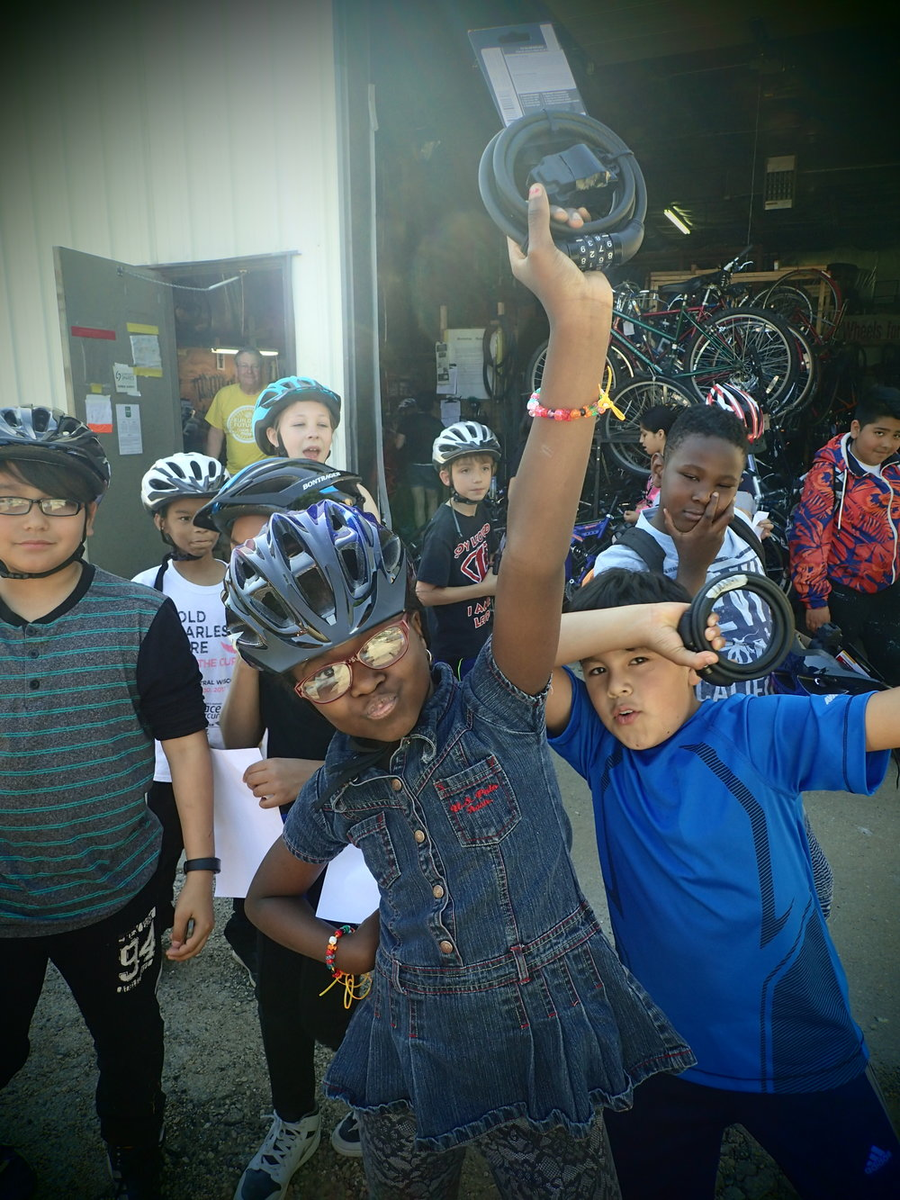 A lively group from Leopold Elementary's Student Advocacy Team came by to pick up their bicycles, helmets, and locks. With the help of Healthy Kids Collaborative, this group of nominated 3rd-5th grade leaders met weekly to assess the health and wellness of their school grounds and local neighborhood. They created a presentation detailing strengths and challenges, and they provided suggestions for improvement. Their presentation was received by the Madison Bike Equity committee.