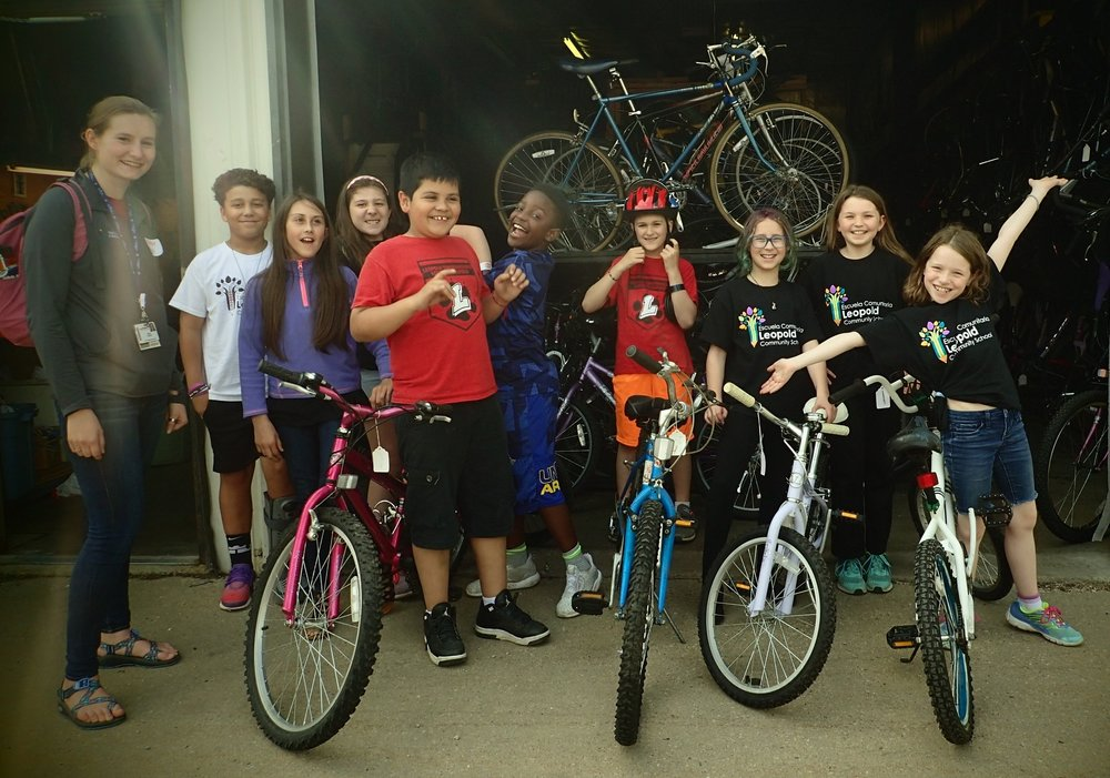 "The students in the Leopold Student Advocacy Team (self-named Leopold Community Leaders) came by to pick out their bikes today. They are students that were selected by their teachers as being influencers in the classroom. The goal of the club is to identify things in their neighborhood that prevent people from being active, then do projects that address some of those needs. The projects that were identified this year include: traffic calming for bike to school day, painting lines for a football field behind the school, and painting benches in front of the school. In addition to their time in the group, the students are also responsible for doing community service outside of the club. The 3rd and 4th graders have been meeting with teacher facilitators of the club during their recess time to help with a variety of projects throughout the school, such as cleaning up garbage on the playground, shelving books in the library, and sorting recycling. The 5th graders are completing their additional service hours by participating in the ""Reading Buddies"" program, where they meet with a kindergartner each week and read with them. Some of the students are also going above and beyond by doing service outside of the club by cleaning up garbage at their local park, cleaning up dog poop at the dog park, and even making blankets for animals at shelters!"