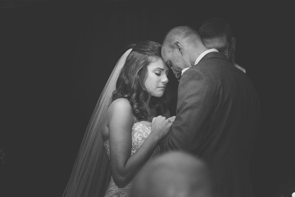 Praying Together by Kansas city wedding Photographer Erin Evangeline Photography