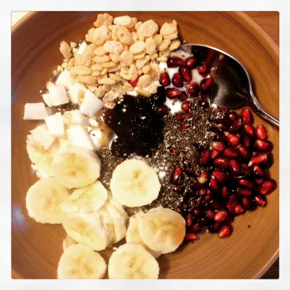 This is topped with pomegranate, more chia, some rice crispies, banana, coconut meat, and blueberry jam.