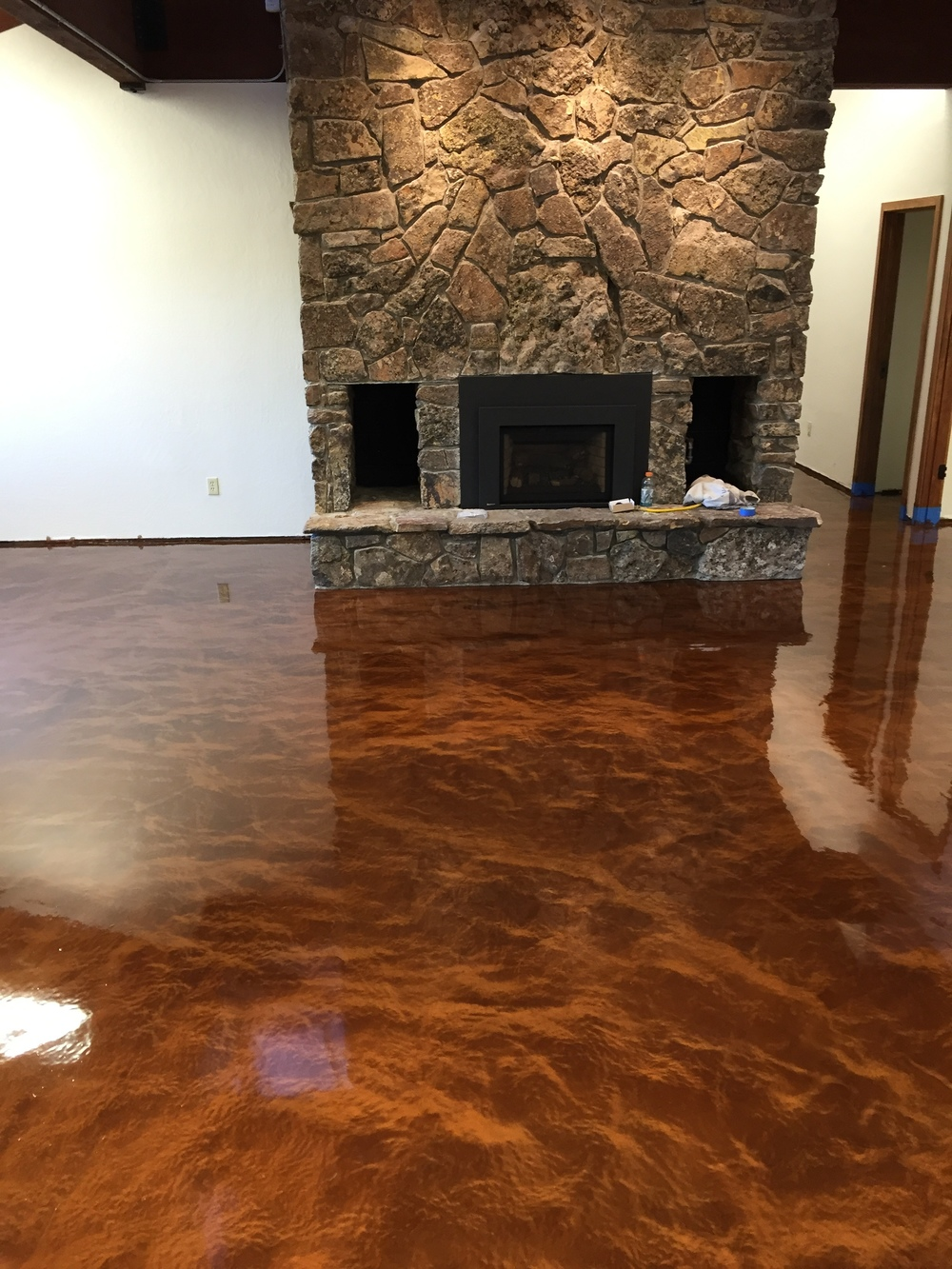 """After the application of the metal fusion floor. This floor color is """"Metal Mocha""""."""