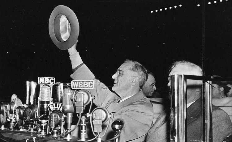 FDR waving his hat to cheering crowds