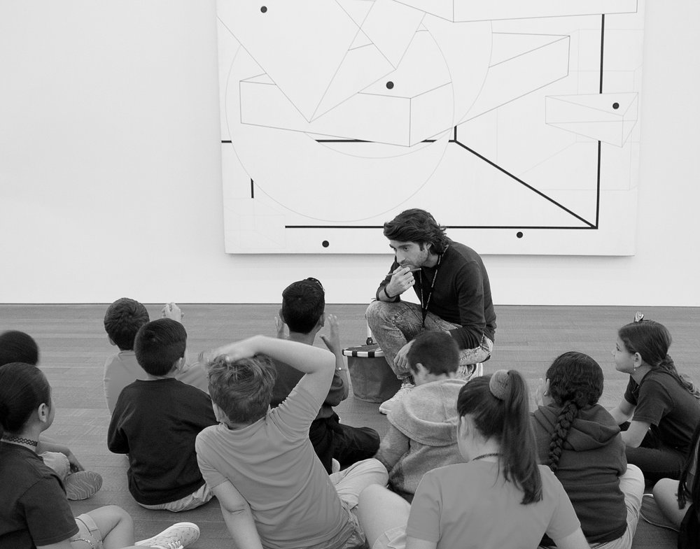 Discussing Al Held's artwork at the Perez Art Museum Miami. Image by Jahaira Rios De Galvez