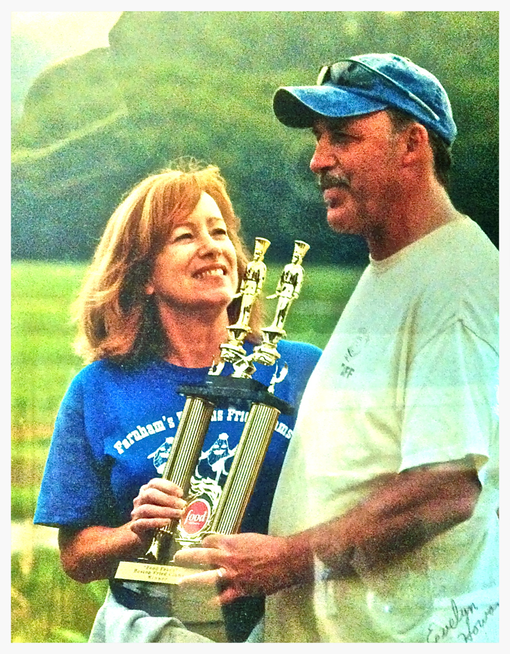 "Terry and Joseph Cellucci are awarded their trophy for ""Best Fried Clam."""