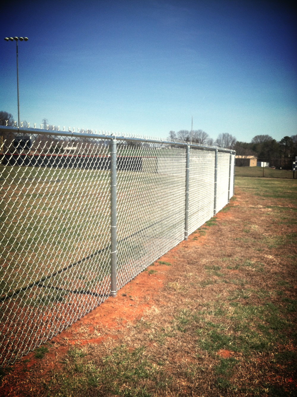 6' High Chain Link Softball field fence at Liberty H.S. in Bedford