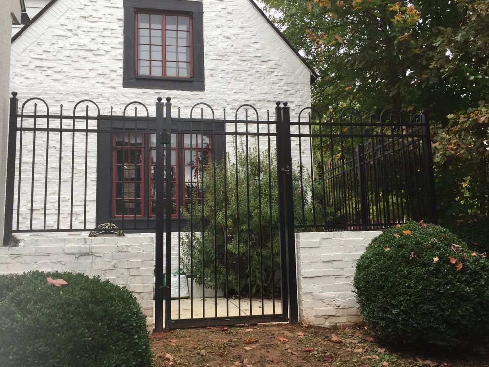 Aluminum courtyard fence in Bedford