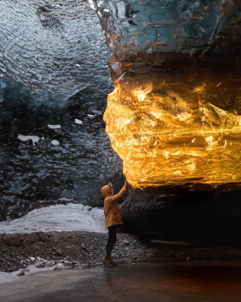 setting-sun-turns-ice-cave-in-iceland-into-amber-by-sarah-bethea.jpg