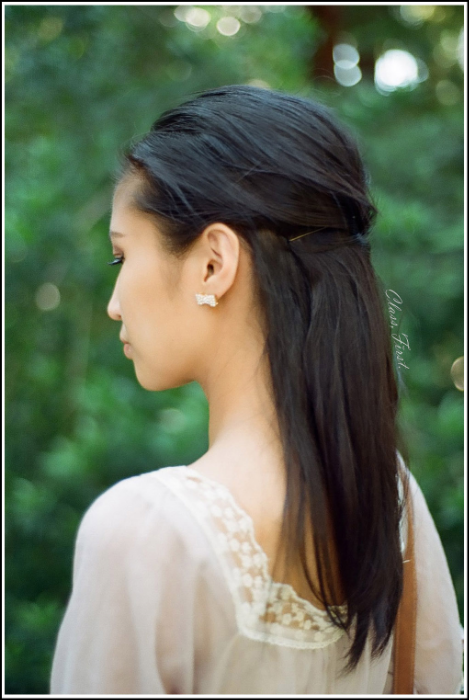Lualhati, LJ. 2013.   Pearl bow earrings and hair pinned back. Simple, light & easy!