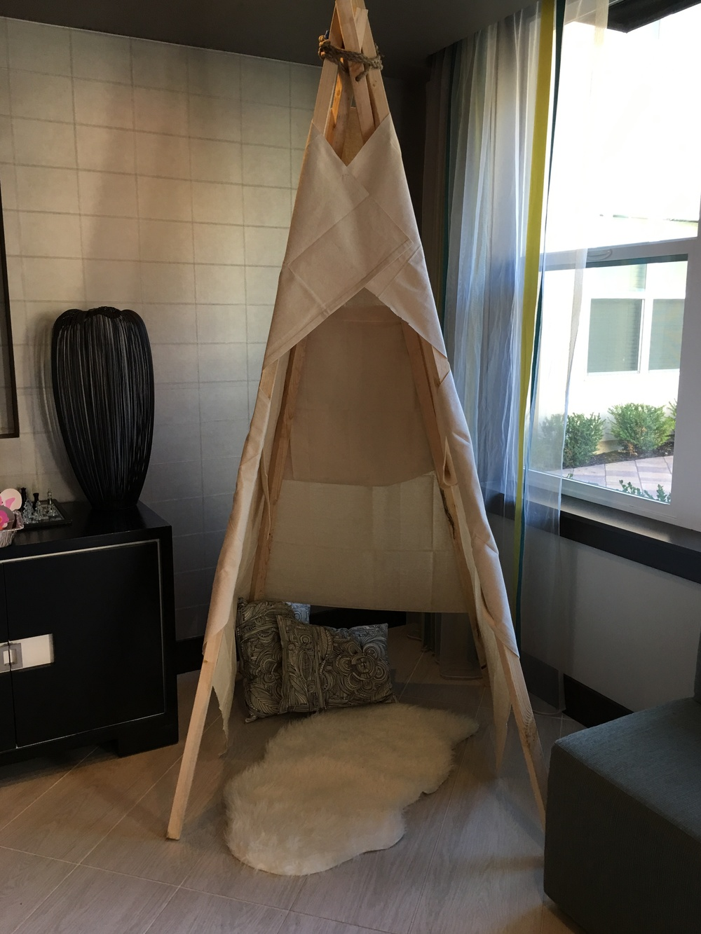 Thanks to LJ for constructing this teepee! he built this teepee from wooden dowels, canvas, and rope.