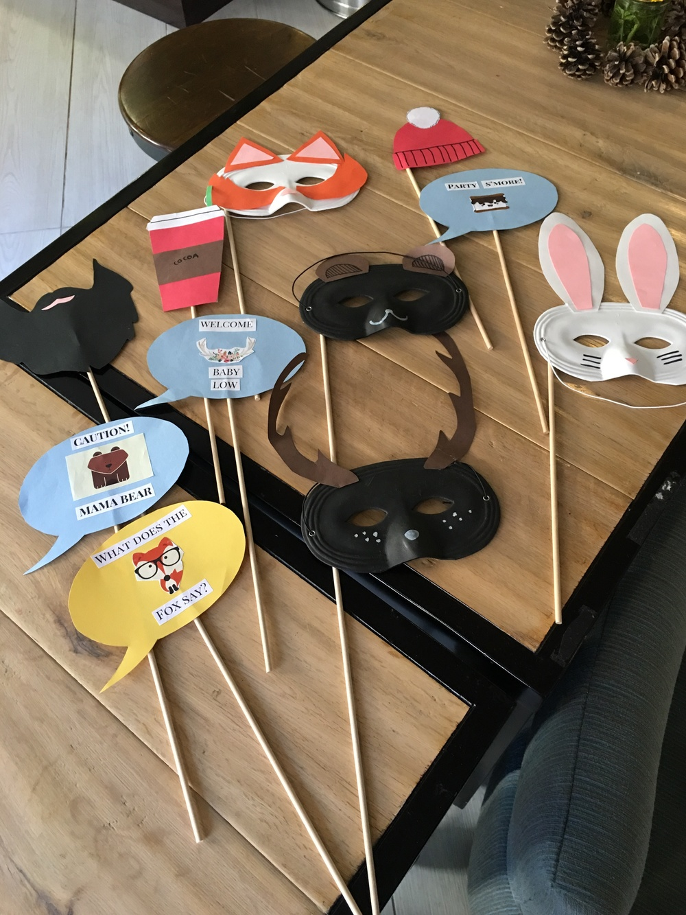 I made these fun photo props! used sticks, masks, and some construction paper templates.