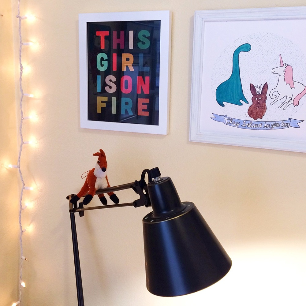 "The ""This Girl Is on Fire"" print is from Live Love Studio, and the ""They Believe In You Too"" print is from my shop. Two awesome motivators!"