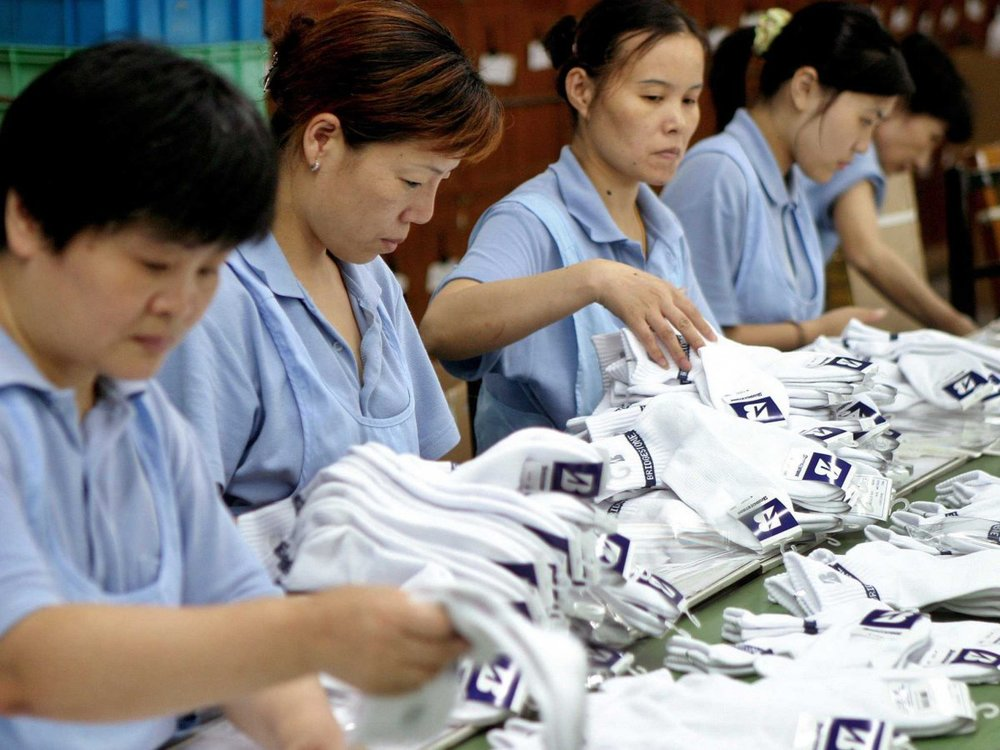About 8 billion pairs of socks are made annually in China's Datang District, also known as sock city.