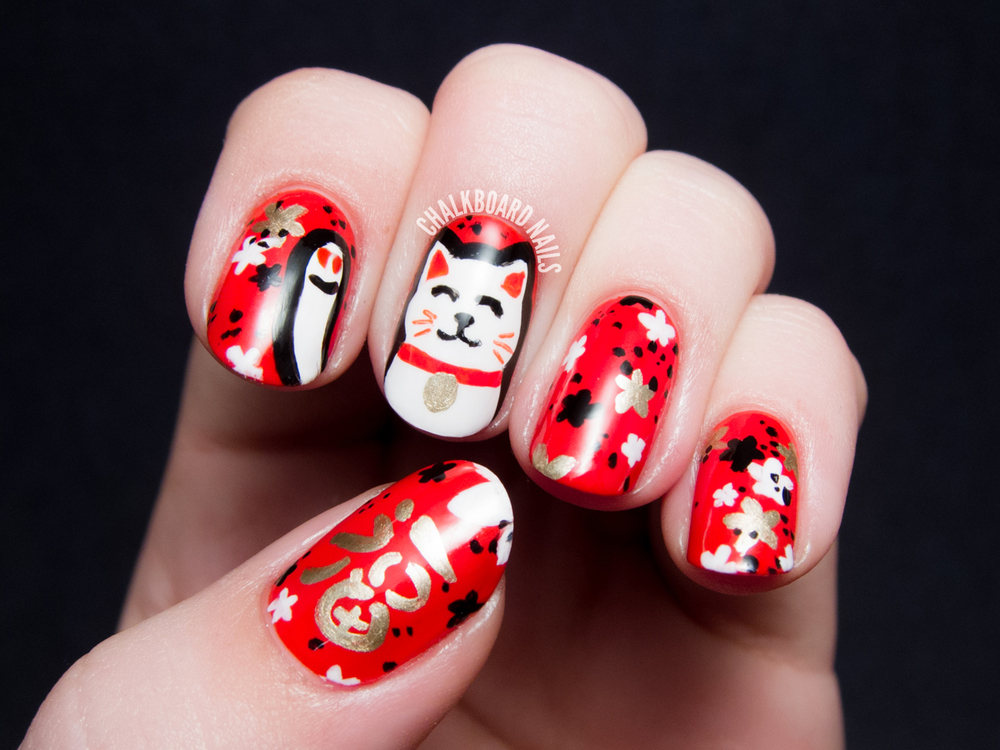 Our favorite Lucky Cat nails by Chalkboard Nails