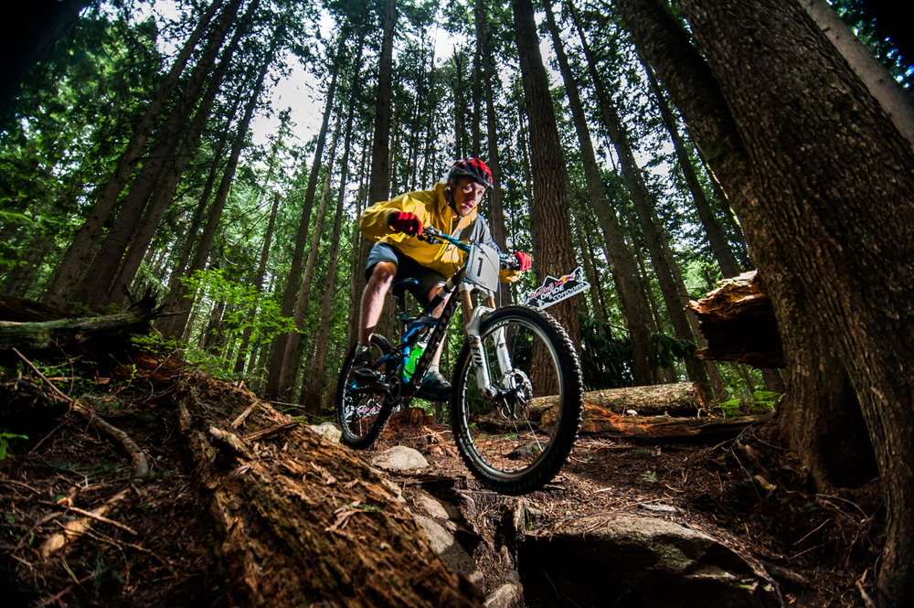 Competitor Kyle Proznick riding downhill in the Red Bull Divide and Conquer multi discipline endurance race held on the North Shore of Vancouver, Canada on the 8th of June, 2013.