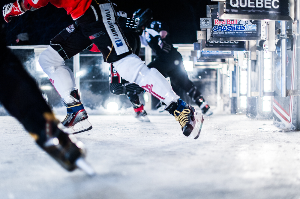 Athlets perform during the finals of the Red Bull Crashed Ice, the last stop of the Ice Cross Downhill World Championship in Quebec, Canada on March 22, 2014.