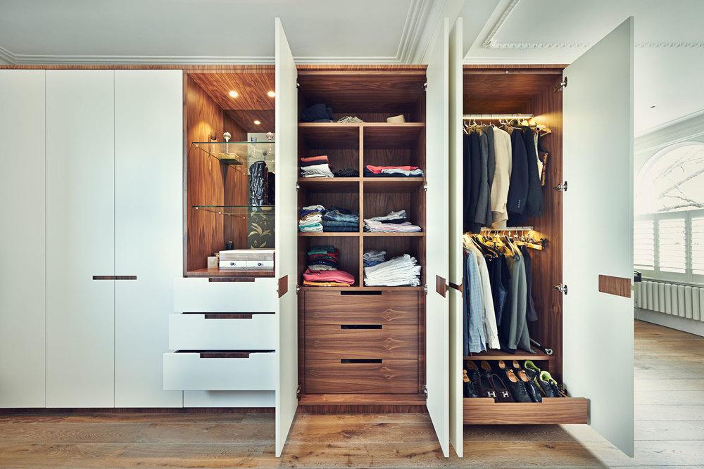 Shellgate Road – a master wardrobe with warm walnut interior and framing