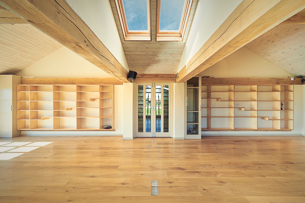 Broadview House – symmetrical playroom shelving in birch ply