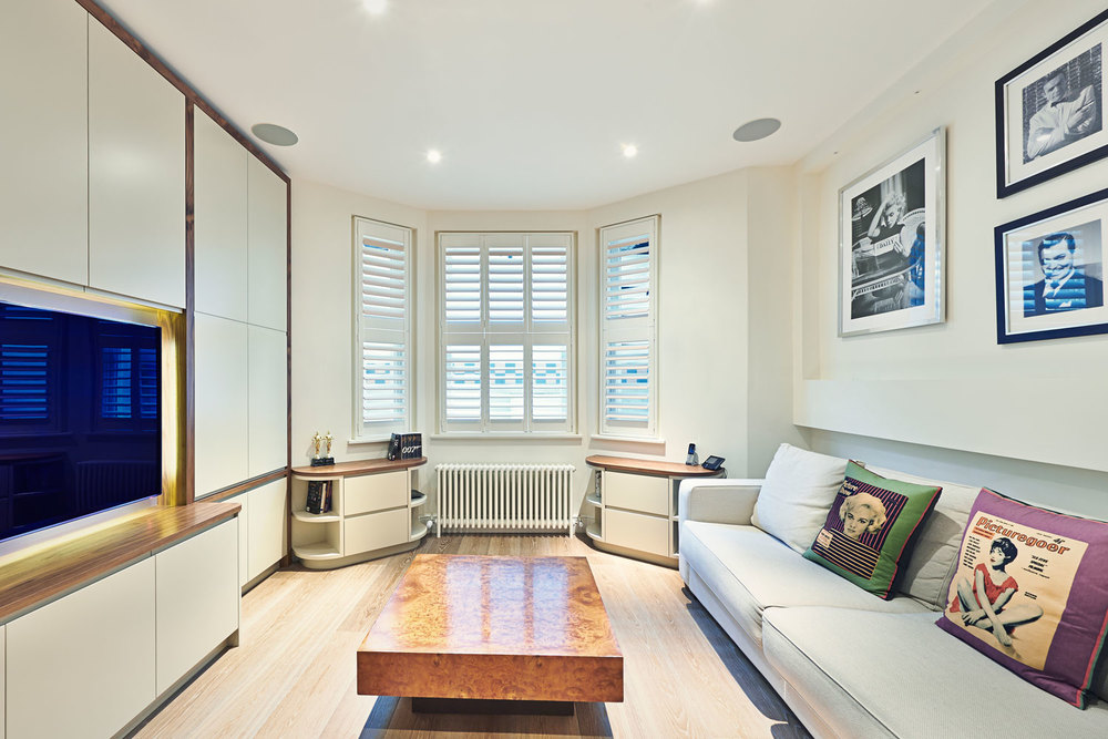 Shellgate Road – a basement media unit with warm walnut framing