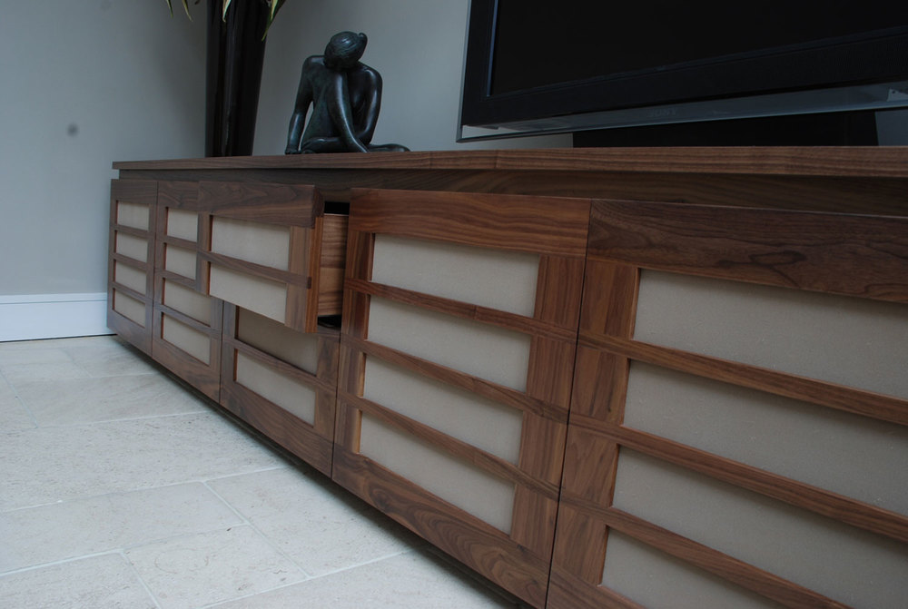 Kings Road – a solid walnut cabinet with inlaid strips and fabric