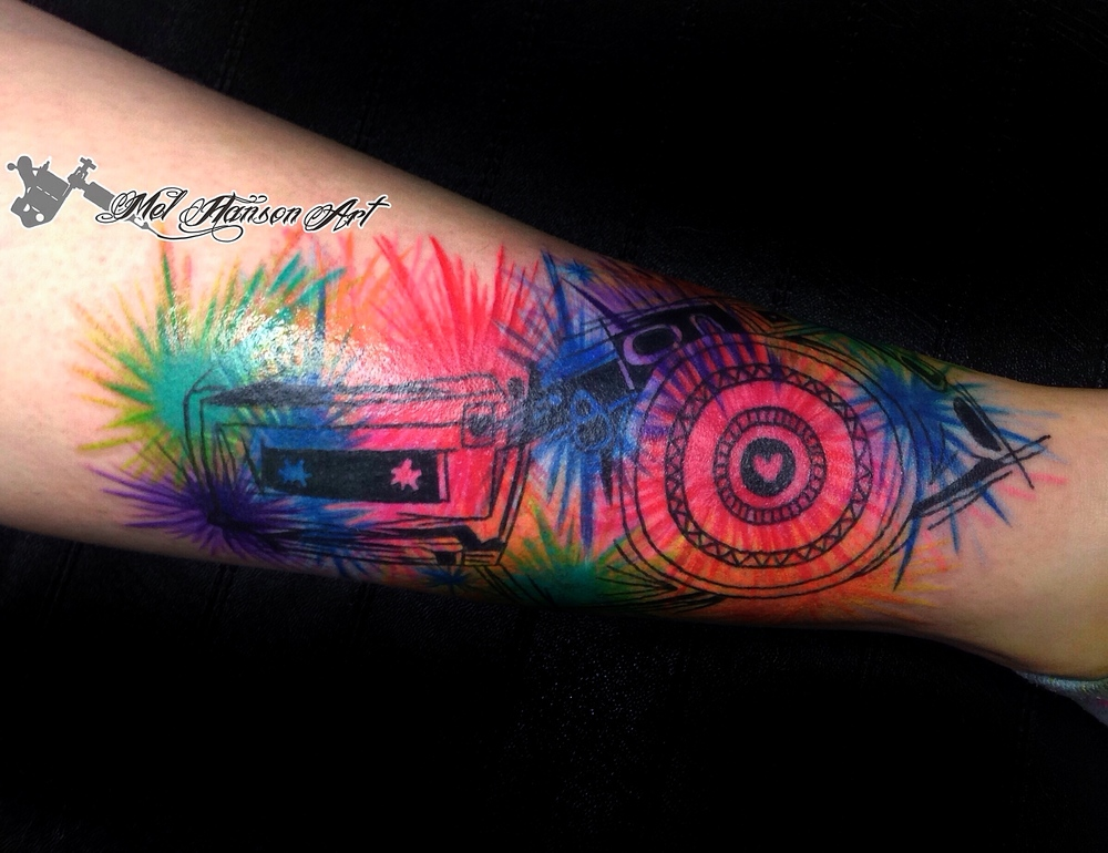 colourful abstract vintage camera and casette tattoo