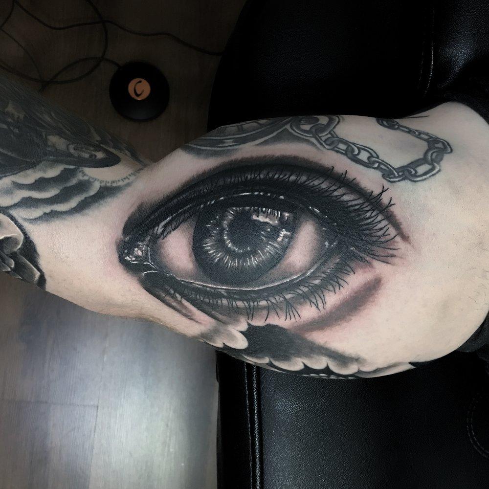 black n grey realistic eye tattoo by mel hanson art