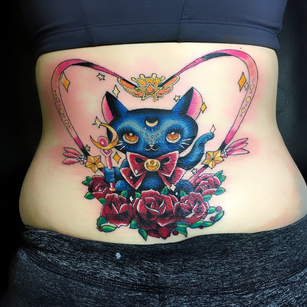 cute colour neo traditional anime cat cover up tattoo by mel hanson