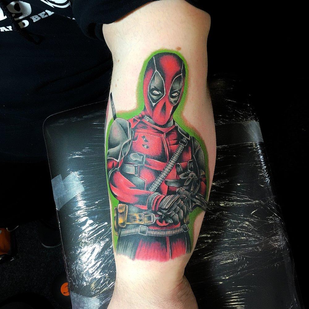 colour deadpool comic tattoo by mel hanson