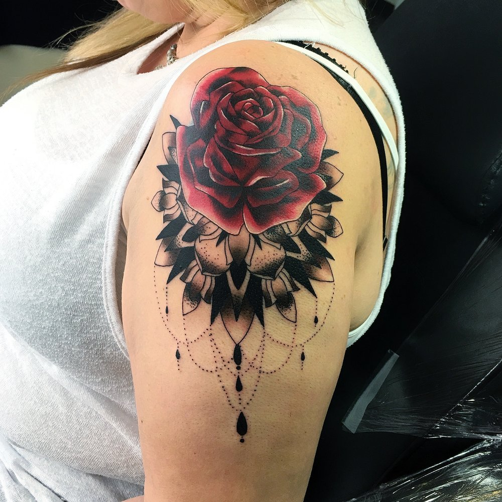 red rose and pattern work cover up on upper arm by mel hanson