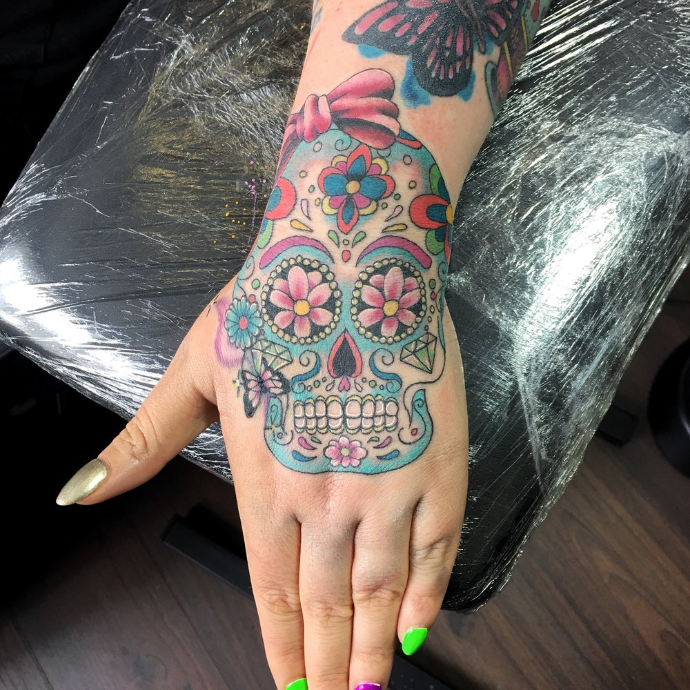 Colour candy skull tattoo by Mel Hanson
