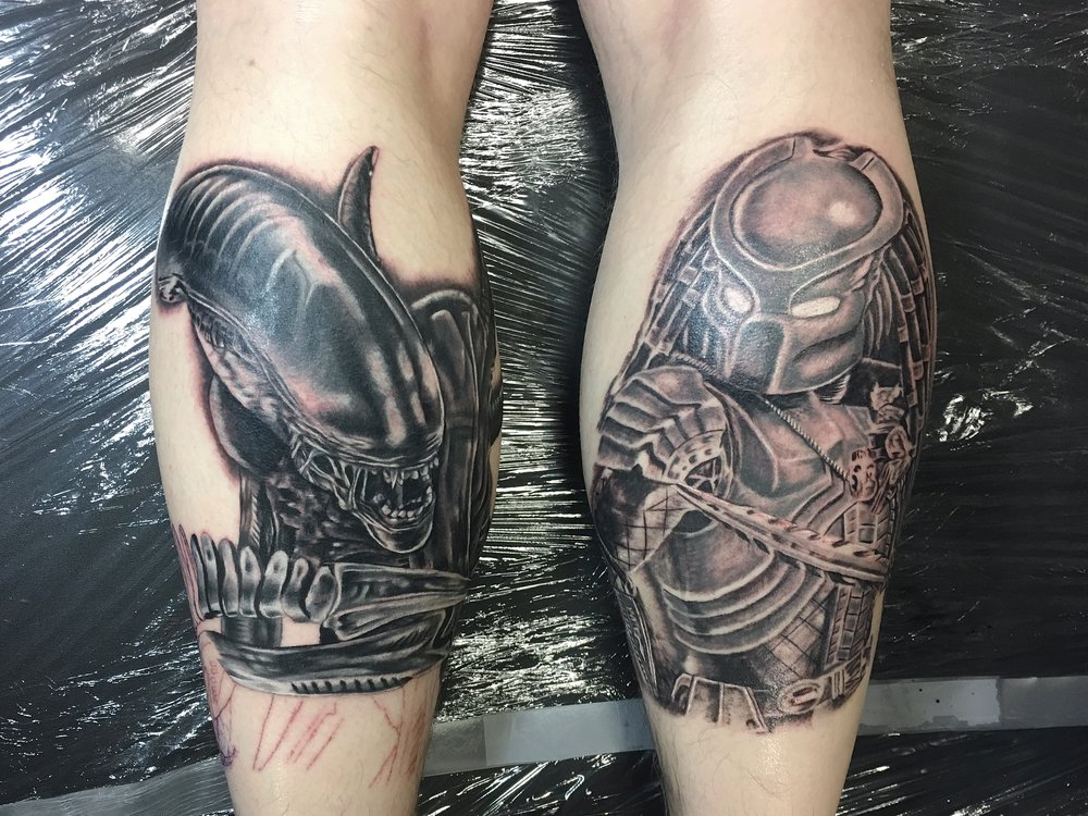 black and grey matching realism alien vs predator tattoos on calf by Mel Hanson and Wayne Baker at Mel's Tattoo Studio, Sittingbourne, Kent UK