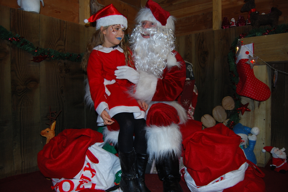 Santa and one of his helpers.JPG