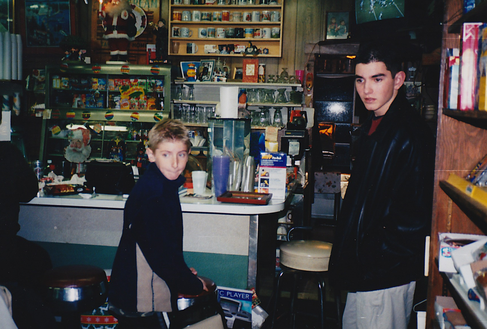 "Grandchildren of Bill Crowley (Bruce and Kip), hanging out at ""The Store,""  circa 2000"
