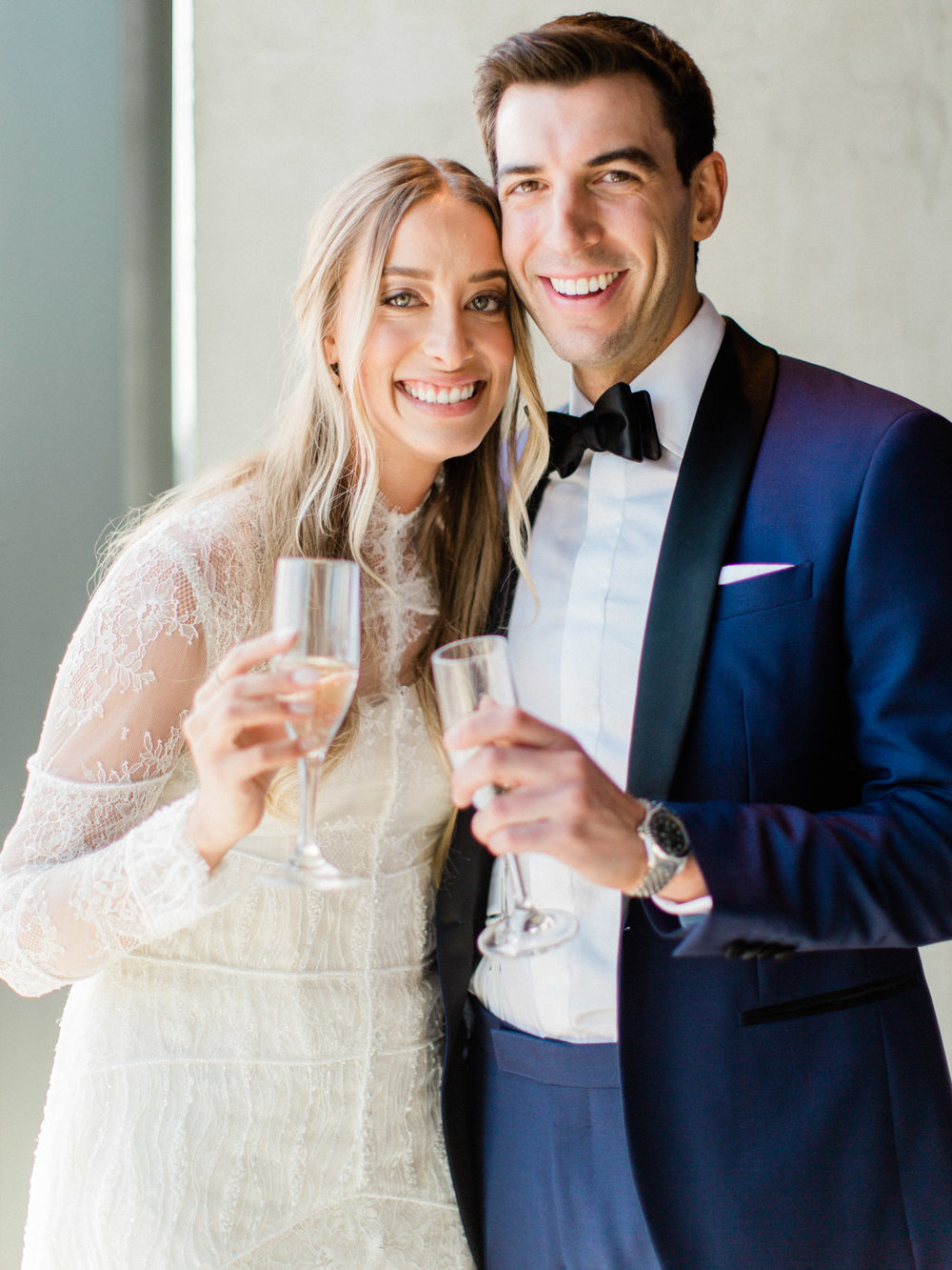 A stylish couple get married on the rooftop of Toronto's newest wedding venue, lavelle restaurant, captured by Toronto documentary wedding photographer Corynn Fowler Photography