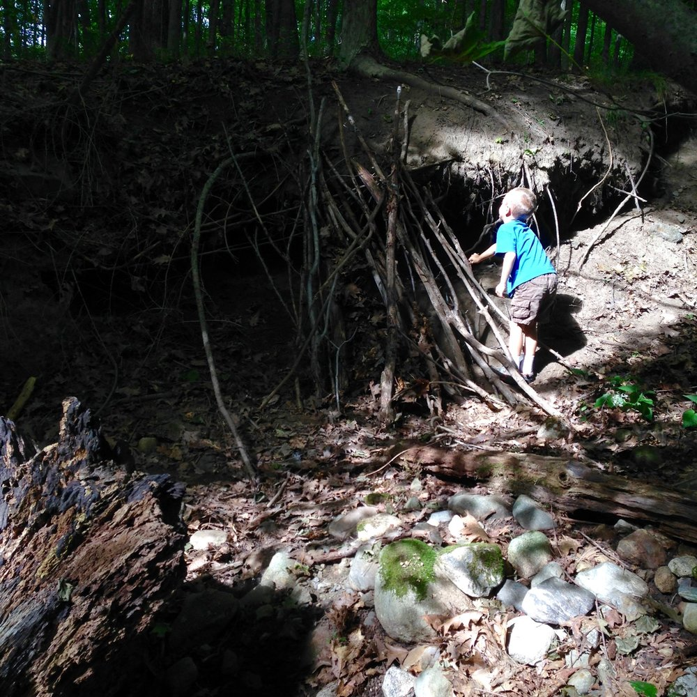Kunsang decided to build a debris shelter to enclose the root cave. He worked with great focus. Eventually Silas and I couldn't resist helping out, too.