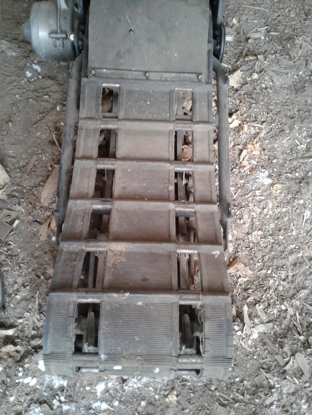 This is one of the old tracks that was damaged. This whole project was about taking off the old and putting on the new track.