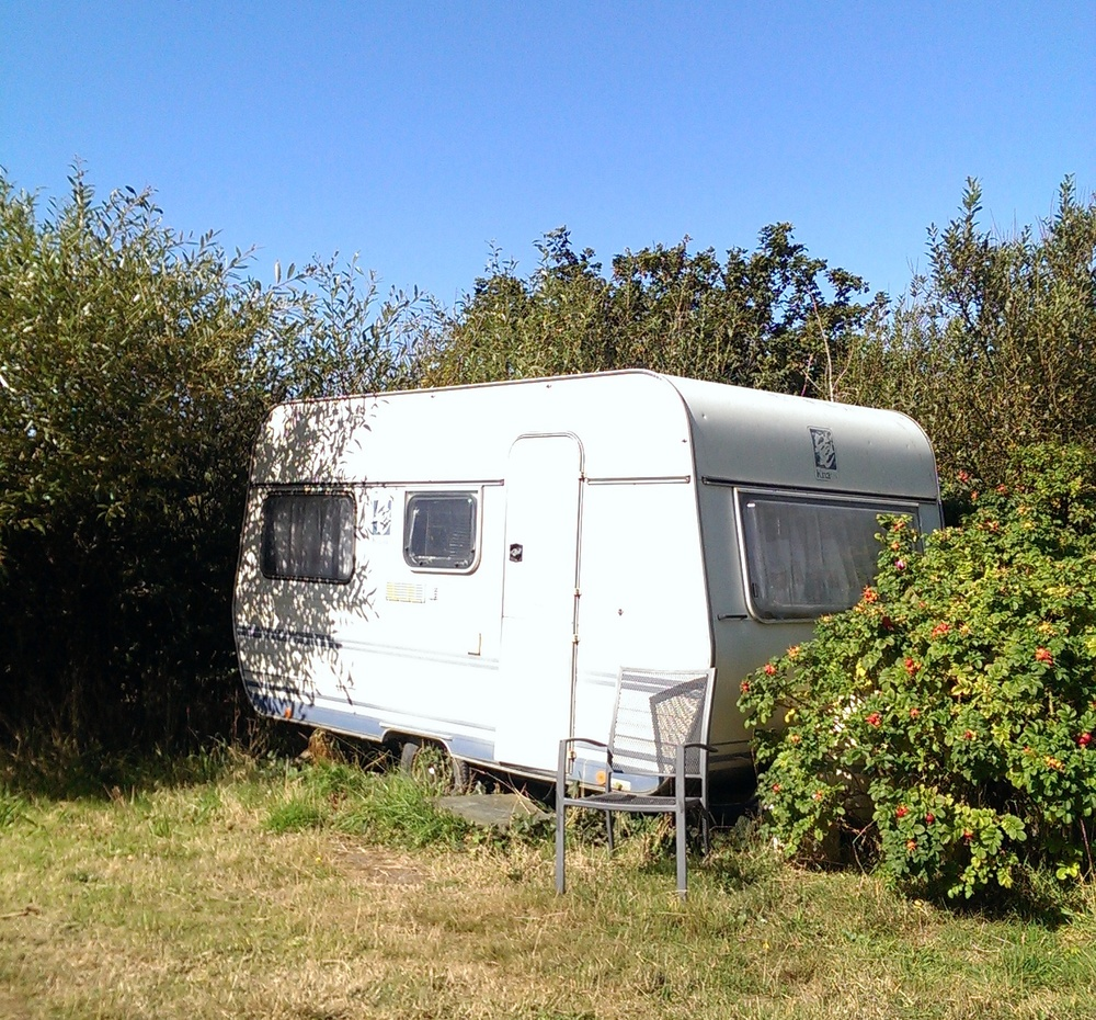 Our caravan for the weekend, nestled in the bushes