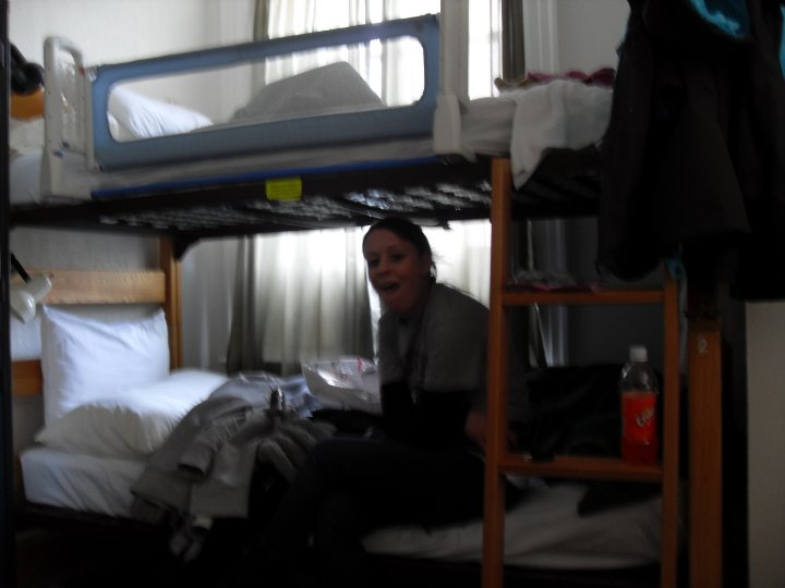Pulling a bizarre face on my bunk-bed.