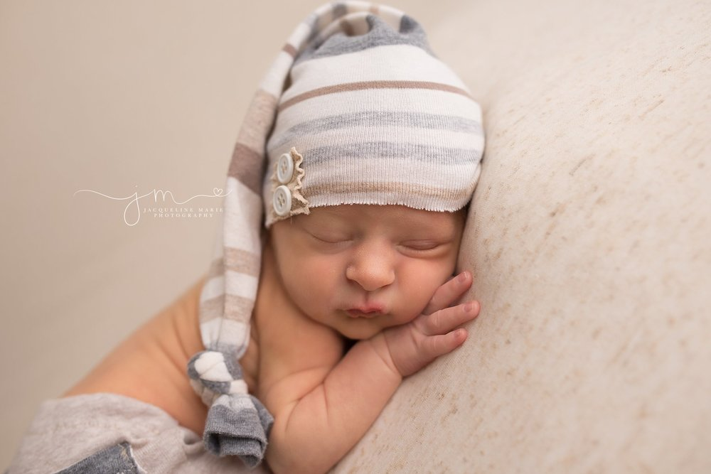 Matching hat and pants are featured in newborn portrait by Columbus Ohio newborn photographer