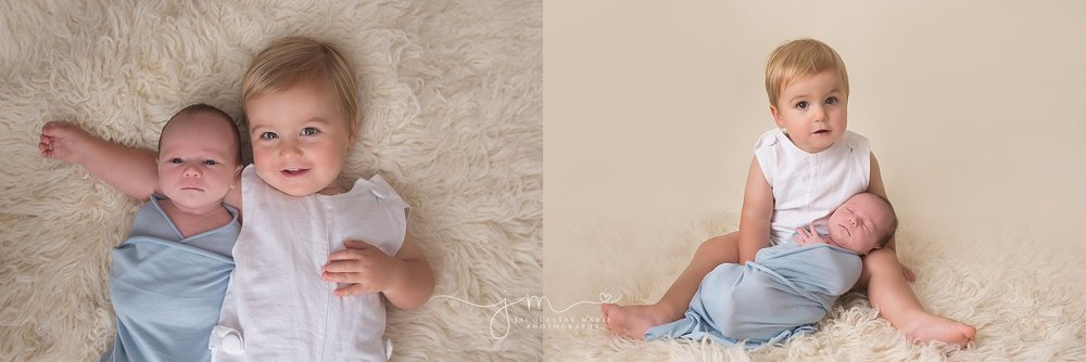 Newborn portrait session in Columbus Ohio features newborn baby swaddled in blue while big brother holds him by Jacqueline Marie Photography