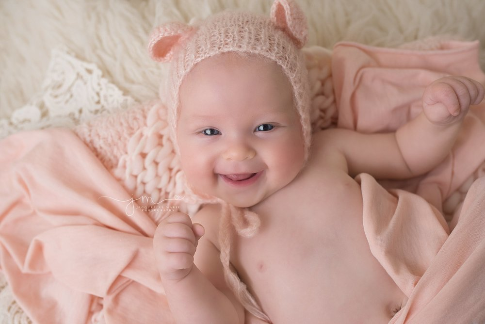 3 month old baby girl wears pink bear bonnet for portrait session at Jacqueline Marie Photography in Columbus Ohio