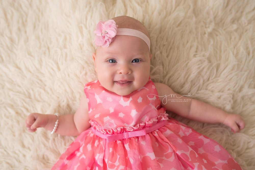 Columbus Ohio baby portrait features 3 month old baby wearing pink dress and pearl bracelet at Jacqueline Marie Photography